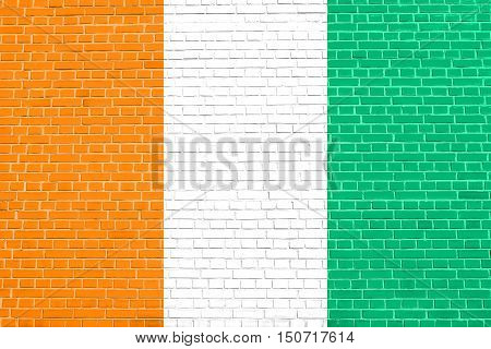 Cote D Ivoire national official flag. African patriotic symbol banner element background. Flag of Ivory Coast on brick wall texture background, 3d illustration