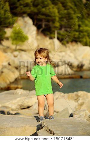 Baby Boy Plays At Sea