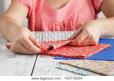 Like My Job. Close Up Of Professional Designer Sitting Near Table And Holding Needle While Sawing