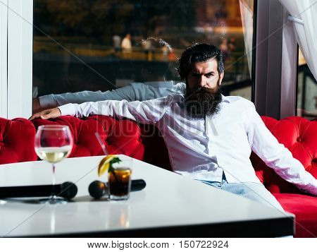 Bearded Man On Couch