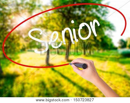 Woman Hand Writing Senior With A Marker Over Transparent Board