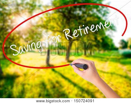 Woman Hand Writing Saving For Retirement With A Marker Over Transparent Board