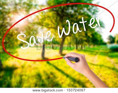 Woman Hand Writing Save Water  With A Marker Over Transparent Board