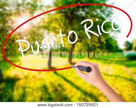 Woman Hand Writing Puerto Rico With A Marker Over Transparent Board