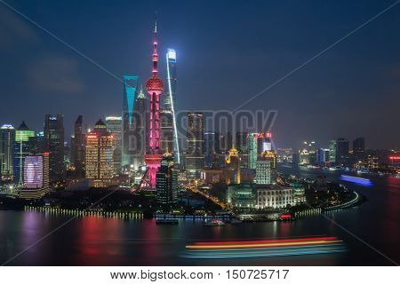SHANGHAI - AUG 14, 2015: TV tower Oriental Pearl and skyscrapers with illumination at night, Tower third highest in Asia