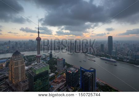 SHANGHAI - AUG 13, 2015: Huangpu River, Oriental tower, Pudong District at evening, Oriental tower has height 468 m (1,535 feet), it was the tallest structure in China from 1994â??2007