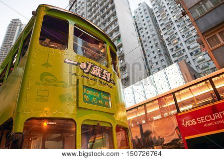 HONG KONG - OCTOBER 25, 2015: double-decker tramway in Hong Kong. Hong Kong is an autonomous territory on the southern coast of China at the Pearl River Estuary and the South China Sea.
