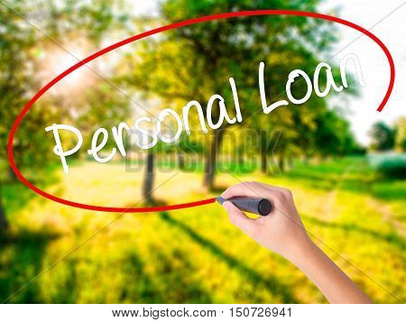 Woman Hand Writing Personal Loan With A Marker Over Transparent Board