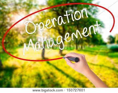 Woman Hand Writing Operation Management With A Marker Over Transparent Board .