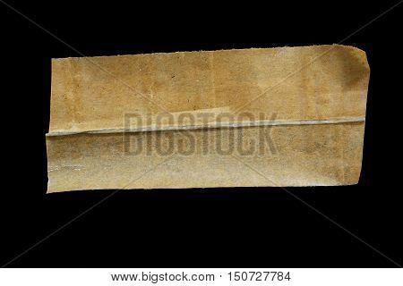 old masking tape isolated on black background