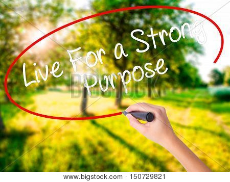Woman Hand Writing Live For A Strong Purpose With A Marker Over Transparent Board