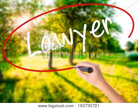 Woman Hand Writing Lawyer With A Marker Over Transparent Board