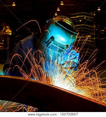 welder welding  Industrial automotive part in car production factory