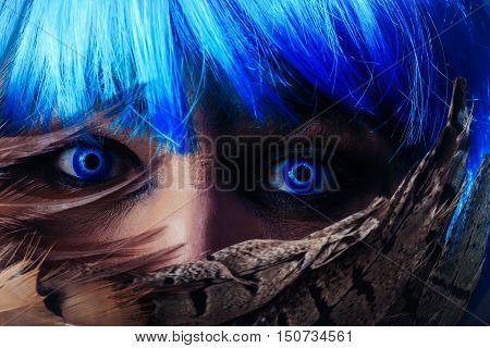 Man In Blue Wig Behing Feathers