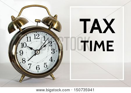 Text Tax time on clock background / time concept