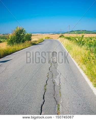country road has a crack due to the landslide of the earth