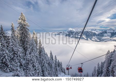 View to Alps in Austria from cable car leading to Hahnenkamm place of famous hahnenkamm races. Kitzbuehel ski resort is one of the best ski resort in the world with 54 cable cars and 170 km prepared skiing slopes.