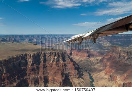 Aerial view of Grand Canyon, shot from airplane, wing visible