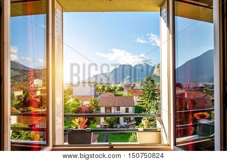 Beautiful cityscape view from the window on the old residential district with mountains in Grenoble city on the east of France