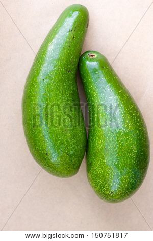 Pair of raw avocados lay on gray background. Yin yang harmony concept