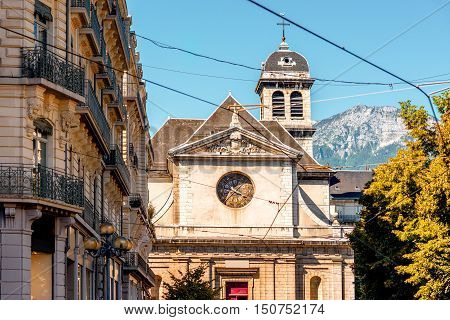 Saint Louis church with bell tower in Grenoble city in France