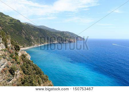 Rocky coast and Cinque Terre village Manarola and Mediterranean Sea Italy