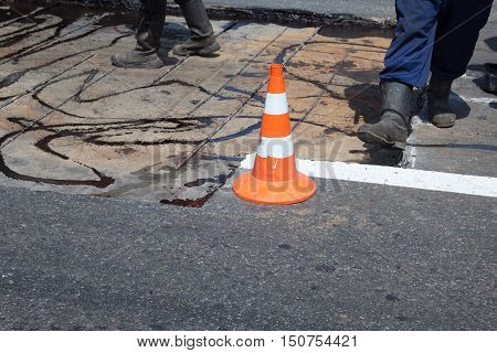 Repairing the asphalt pavement on the road.