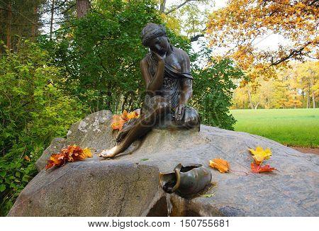 Morning in the Catherine park in Tsarskoye Selo. Girl with a jug
