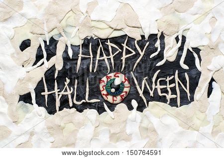 An amazing Happy Halloween postcard with mummy's eyeball and bandage, made from clay.