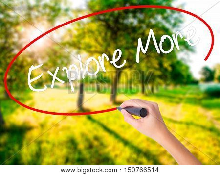 Woman Hand Writing Explore More With A Marker Over Transparent Board