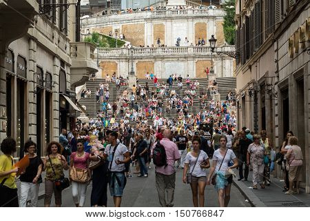 ROME ITALY -JUNE 15 2015: Visitors at the Spanish Steps on June 15 2015 in Rome Italy.Built in 1723-1725 by a design of the architect Francesco de Sanctis and financed by French diplomat Etienne