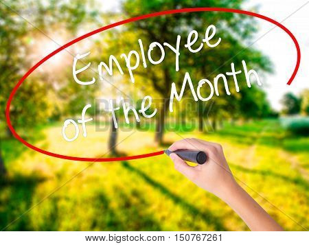 Woman Hand Writing Employee Of The Month  With A Marker Over Transparent Board