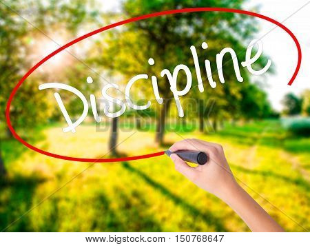Woman Hand Writing Discipline With A Marker Over Transparent Board