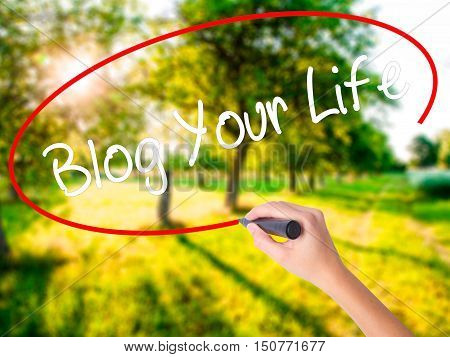 Woman Hand Writing Blog Your Life With A Marker Over Transparent Board