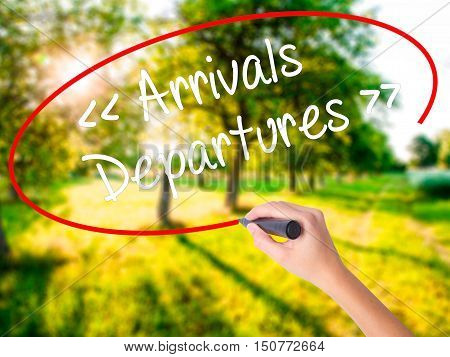 Woman Hand Writing Arrivals - Departures With A Marker Over Transparent Board .