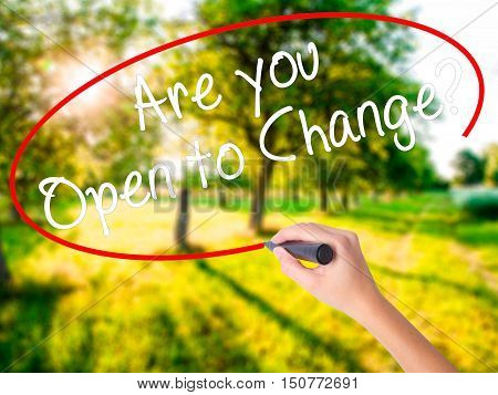 Woman Hand Writing Are You Open To Change? With A Marker Over Transparent Board