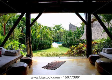 sitting in the middle of own villa bali , with the beautiful green view and the pool on the middle ..