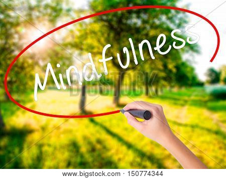 Woman Hand Writing Mindfulness  With A Marker Over Transparent Board