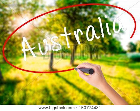 Woman Hand Writing Australia With A Marker Over Transparent Board