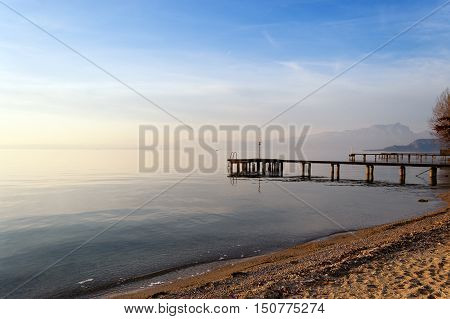 Lago di Garda at twilight in winter (Garda Lake) the largest Italian lake of glacial origin. Lazise Veneto Italy