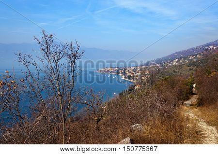 Garda lake (Lago di Garda) and the coast with the small town of Torri del Benaco in winter. Verona Veneto Italy