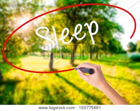 Woman Hand Writing Sleep With A Marker Over Transparent Board