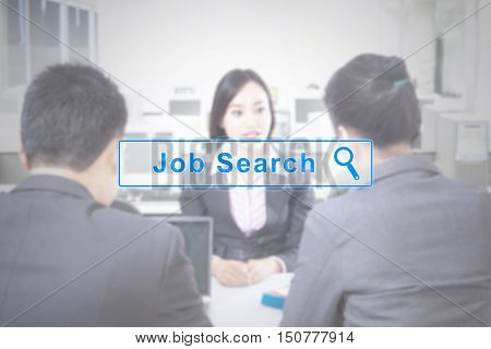 Concept of Job Search with a virtual job search button and businesspeople sitting in a job interview
