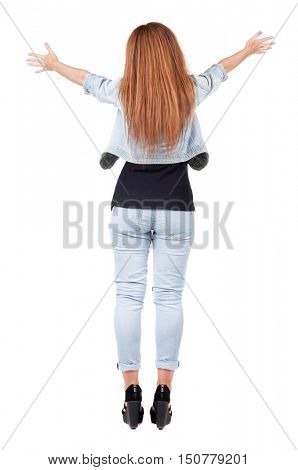 back view of walking  woman. beautiful redhead girl in motion.  backside view of person.  Rear view people collection. Isolated over white background. happy girl goes with the placed his hands open to