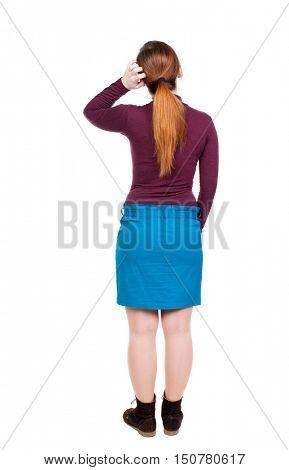 back view of standing young beautiful  woman.  girl  watching. Rear view people collection.  backside view of person.  Isolated over white background.girl in dress modest scratches his head in