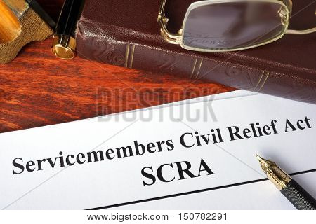 Servicemembers Civil Relief Act (SCRA) and a book.