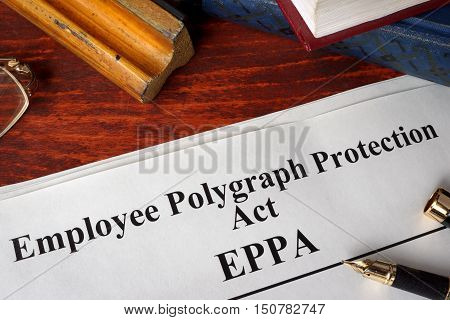 Employee Polygraph Protection Act EPPA and a book.