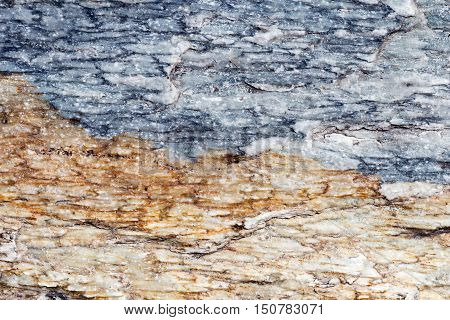 Detailed stone surface texture blue and brown marble slabs with cracks detailed structure of stone in natural patterned for background and design.