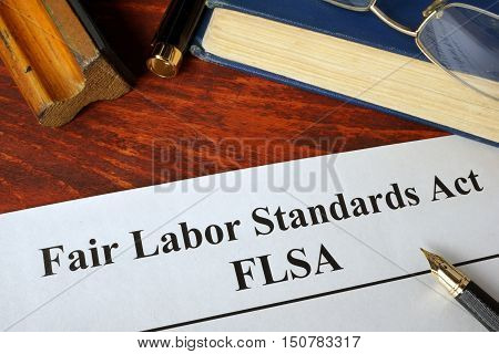 FLSA Fair Labor Standards Act and a book.