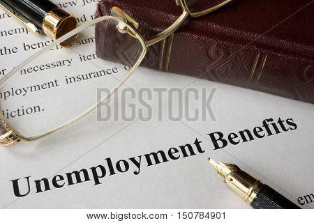 Unemployment Benefits concept written on a paper.